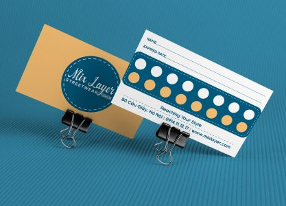 Two blank business card on color background.
